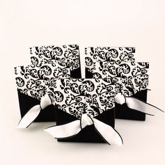 Ivory And Black Flourish Favor Boxes With Ribbons